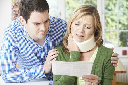 image of accident victim reviewing medical bills