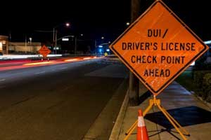 Image showing a sign for a DUI and drivers license checkpoint ahead