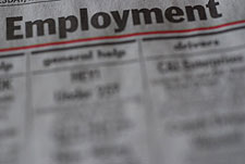 Image depicts an employment section in newspaper as a visual example of grounds for modification