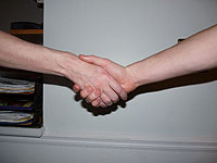 image depicts two people shaking hands and reaching an agreement for alimony modification