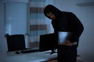 Photo of Thief Stealing Computers from Office